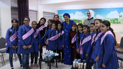 UN Deputy Secretary General Ms. Amina Mohammed takes a group photo with students who are members of the School Parliament at Nuzha Elementary Girls School during Ms. Amina's visit to UNRWA in Nuzha area, Amman on 9 December 2019. © 2019 UNRWA Photo by Daniah Al-Batayneh.