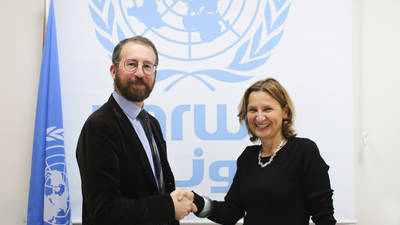 The Head of the Representative Office of Austria in Ramallah, Astrid Wein (right), shakes hands with UNRWA Chief of Donor Relations Mr. Marc Lassouaoui, at UNRWA HQ in Jerusalem following the signing of an agreement amounting to EUR 2 million. © 2019 UNRWA Photo by Elizabeth Meyer