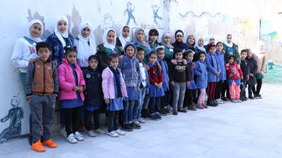 Student teachers and their little students from the UNRWA Jabal El-Hussein Basic School in Amman, Jordan. © 2019 UNRWA photo by Dania Al-Batayneh.