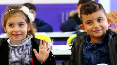 تلميذ وتلميذة في مدرسة غزة المختلطة الجديدة، غزة © الأونروا 2020 ، تصوير خليل عدوان