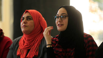 Palestine refugee women participate in an activity about protection, child detention and the use of live fire in the UNRWA Arroub Community Centre, West Bank. © 2019 UNRWA photo by Marwan Baghdadi.