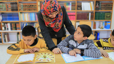 A teacher works with her students in an UNRWA school in Arroub camp, West Bank. © 2015 UNRWA Photo by Alaa Ghosheh