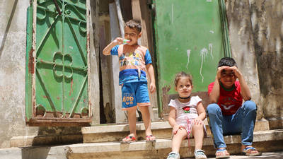 Palestinian refugees from Syria sitting in front of their rented house in Beddawi refugee camp, Lebanon. © 2019 UNRWA photo by Maysoun Mustafa.
