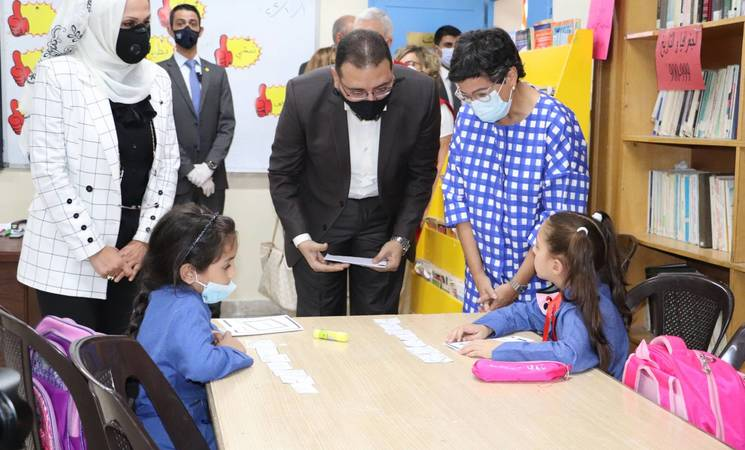 The Minister of Foreign Affairs, European Union (EU) and Cooperation of Spain, H.E Ms. Arancha González Layas (right), talks to two young students during her visit to the UNRWA Nuzha Elementary Girls' School north of Amman on 1 October 2020. @ 2020 UNRWA Photo by Lubna Hashem