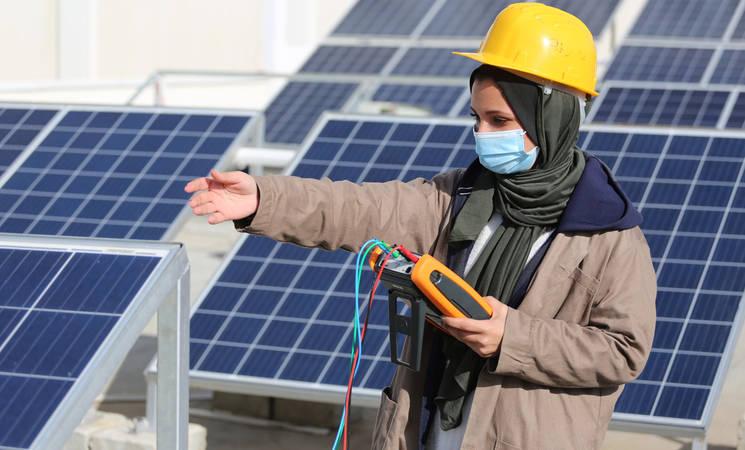 UNRWA student, Ghada Kerryam, practicing installation and maintenance of photovoltaic systems at UNRWA Gaza Training Centre (GTC).©Photo credit 2020 UNRWA Photo by Khalil Adwan.