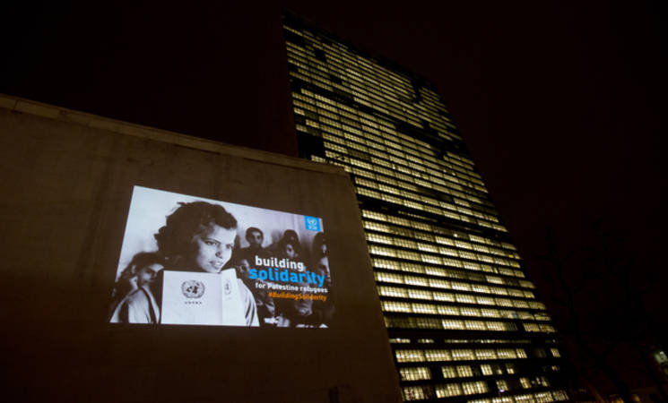 An iconic image from UNRWA's newly digitized archive projected on the UNHQ building, Manhattan, New York as part of UNRWA's Building Solidarity campaign, 2 December 2014.