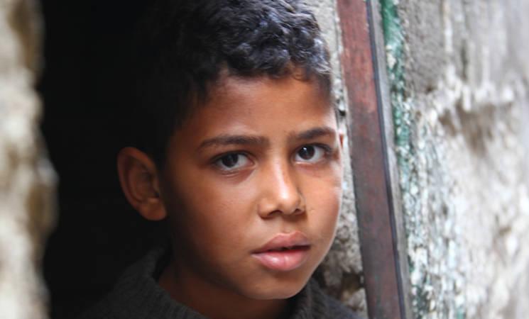 Young boy in Qabr Essit camp, December 2014. © UNRWA/Taghrid Mohammad
