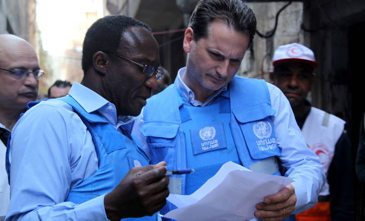 Director of UNRWA Affairs in Syria Michael Kingsley-Nyinah (left) and UNRWA Commissioner-General Pierre Krähenbühl during a visit to Yarmouk refugee camp in Syria, 10 March 2015. © 2015 UNRWA Photo by Taghrid Mohammad