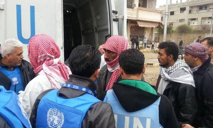 Palestine refugees receive critical humanitarian assistance in Yalda, 13 April 2015. © 2015 UNRWA Photo