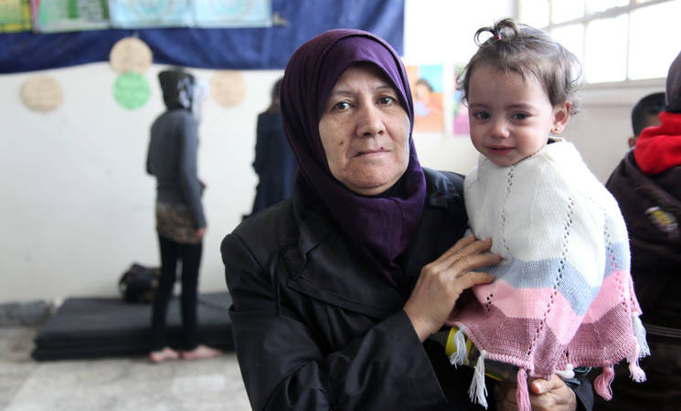 Today, UNRWA provided life-saving humanitarian support to 94 civilians who fled Yarmouk and found refuge in the Zeynab Al-Hilalyah government school in Tadamon. © 2015 UNRWA Photo by Taghrid Mohammad