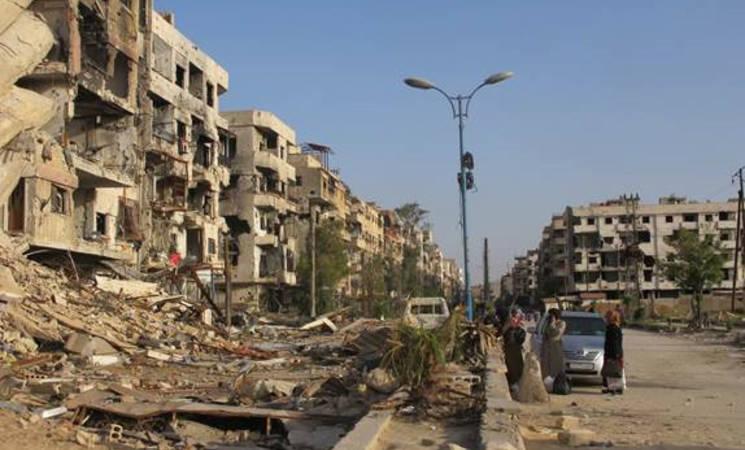 Destruction on the route to Beit Saham, 19 April, 2015 © 2015 UNRWA Photo