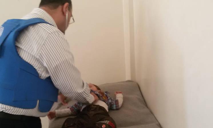 A young boy receives medical treatment in Yalda, 26 April, 2015 ©UNRWA