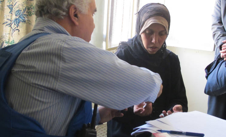 A woman receives medical treatment from an UNRWA doctor in Yalda. © 2015 UNRWA Photo