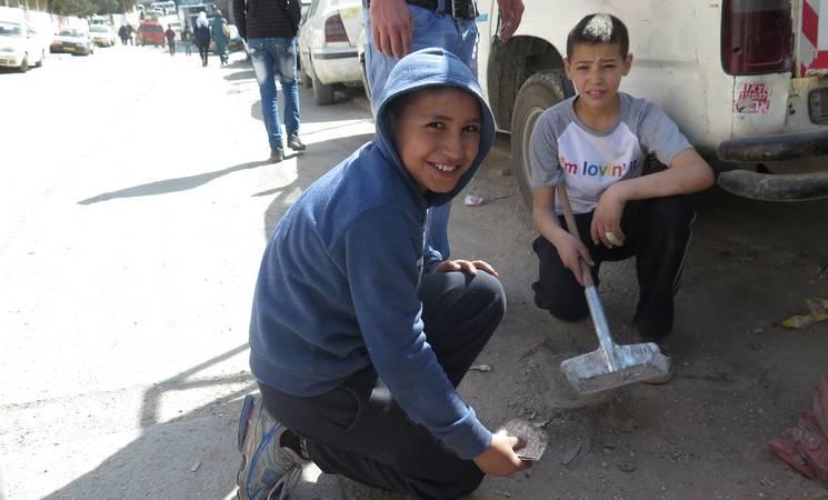Heiaf (right) taking part in the Health Camp Initiative. © 2015 UNRWA Photo by Ruba Hafayda