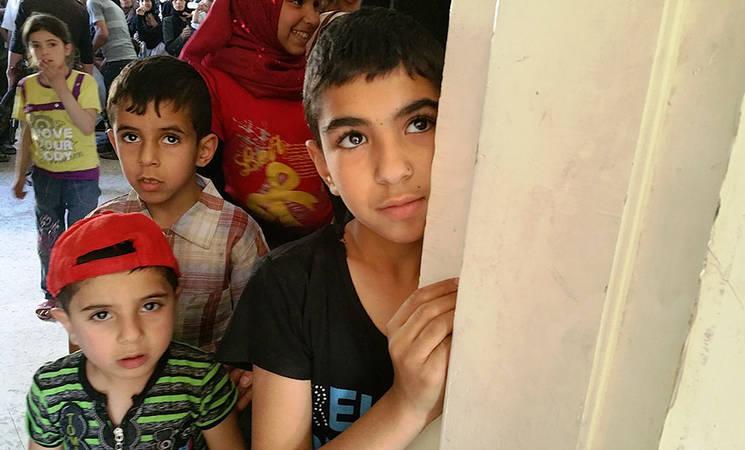 Children queue for the UNRWA medical point in Yalda, 17 May, 2015. © 2015 UNRWA Photo