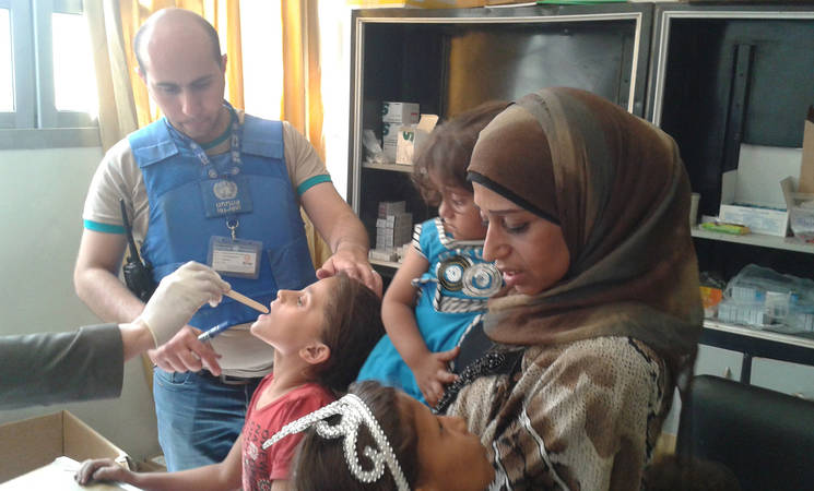 Displaced children receive UNRWA medical services in Yalda shelter, 25 May, 2015. © 2015 UNRWA Photo