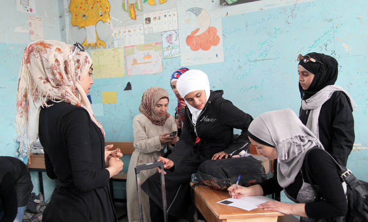 Ninth grade students living in Yarmouk and Lebanon arrive to board at an UNRWA school to prepare and sit for national exams. UNRWA Alliance School, Damascus, May 2015. © 2015 UNRWA Photo by Taghrid Mohammed