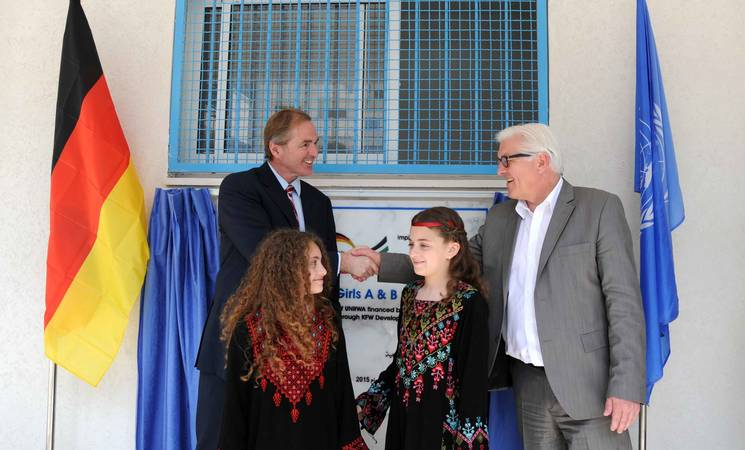 German Foreign Minister Frank-Walter Steinmeier and UNRWA Director of Operations in Gaza Robert Turner in front of the inauguration plaque of Asma Prep Girls A&B school. © 2015 UNRWA Photo by Ahmed Awad