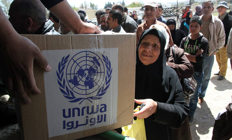 Beneficiaries receive UNRWA food parcels, made possible with generous support from the UAE. Sahnaya, Damascus. © 2015 UNRWA Photo by Taghrid Mohammad