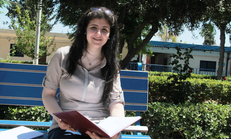 Seventeen-year-old Nada Shawaheen placed first in the literary section of this year's national twelfth grade exams in Syria. Her family was forced to flee their home in Yarmouk when armed violence broke out inside the camp in December 2012. © 2015 UNRWA Photo by Taghrid Mohammad.
