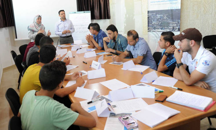 Youth gathered to participate and input ideas through a focus group meeting regarding camp improvement priorities. © 2015 UNRWA Photo by Khalil Adwan
