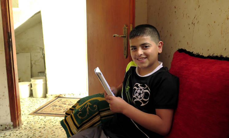 Mahmood, a young teenager growing up in Arroub camp, was shot by Israeli security forces (ISF) firing plastic-coated metal bullets last summer. Over the last several years, the use of live ammunition by the ISF in West Bank refugee camps has increased. © 2015 UNRWA Photo by Ruba Hafayda