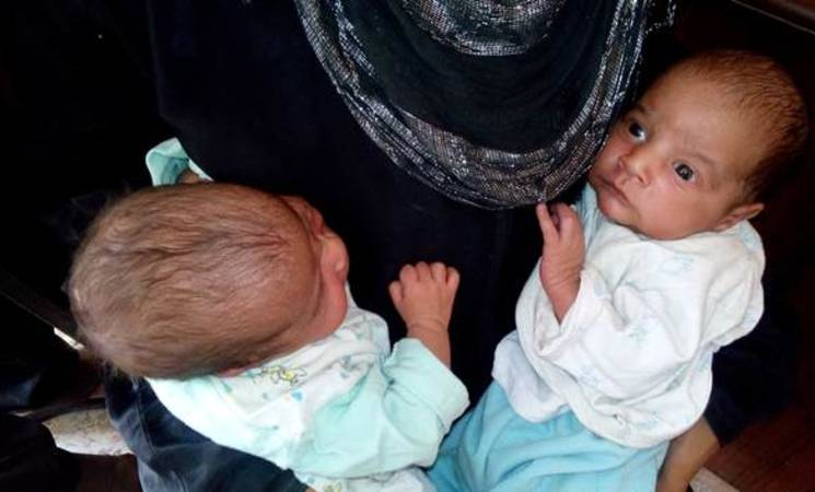 Two infants at the UNRWA medical point in Yalda, 10 September, 2015. © 2015 UNRWA Photo