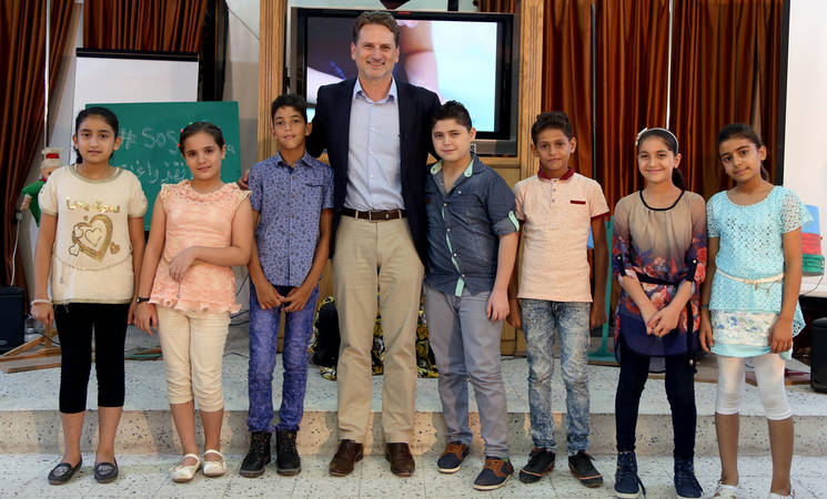"""UNRWA Commissioner-General Pierre Krähenbühl meets the seven child actors of the SOS-film """"Message in a Bottle"""", produced by UNRWA TV in June 2015. © 2015 UNRWA Photo by Khalil Adwan"""