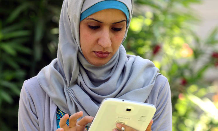 Rasha Abu Safieh, manager of the Gaza Gateway team, which played an important role in the development of the software for the Poverty Assessment System (PAS). © 2015 UNRWA Photo by Khalil Adwan