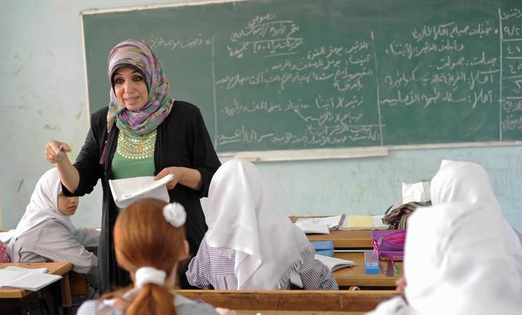 Suheir al-Khaldi teaches Arabic at the UNRWA Preparatory A School in Nuseirat, central Gaza. © 2015 UNRWA Photo by Tamer Hamam
