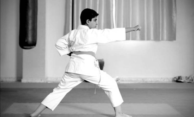 RCVI student Abdel Rahman performs one of the karate moves he learned during his training classes at al-Mashatal sports club in Gaza City. ©2015 UNRWA  Photo by Tamer Hamam