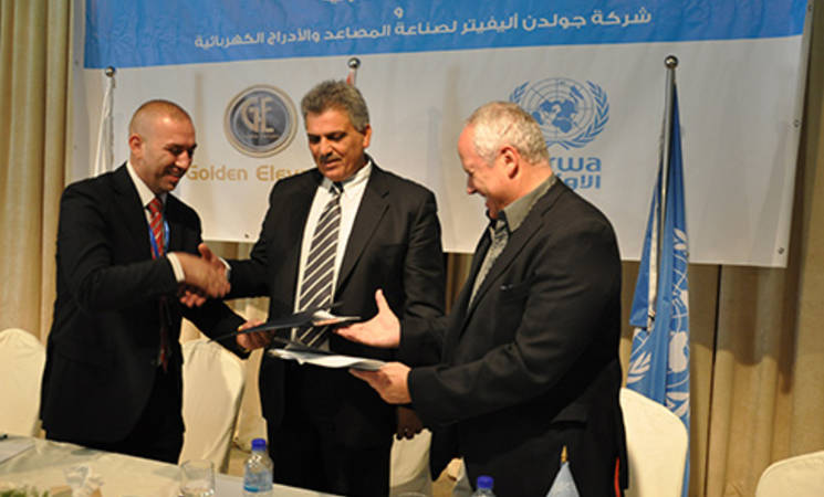 Mr. Hussam Kiresh, the general director of the Golden Elevators Company, Mazin Ghuniem Deputy Minister of Local Government Palestinian Authority, Felipe Sanchez Director, of UNRWA Operations, WBFO, UNRWA.