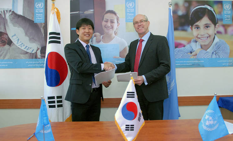 Youngwoo Kim, Country Director of the KOICA Palestine Office, and Matthias Burchard, Acting Director of the Department of External Relations and Communications at UNRWA, signed an agreement on 26 February confirming Korea's contribution of US$ 447,996 to UNRWA in support of the Agency's technical and vocational education and training programme in Gaza. © 2016 UNRWA Photo by Leslie Yun