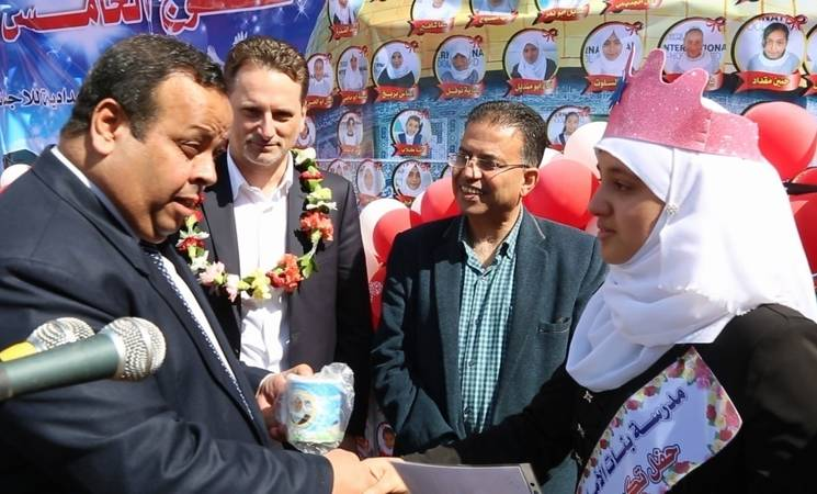 A'hed Salameh from Al-Amal Preparatory Girls School in Khan Younis receives her certificate from UNRWA Commissioner-General Pierre Krähenbühl and Chief of the UNRWA Education Programme in Gaza Farid Abu Athra during the school's honouring ceremony for high achieving students. © 2016 UNRWA Photo by Ibrahim Yaghi