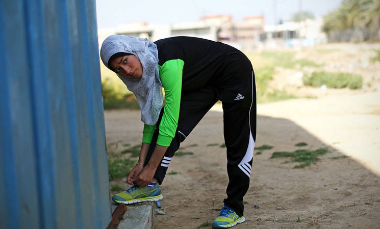 15-year-old Palestine refugee Inas Nofal is preparing for her daily four-hour training session in Al Maghazi camp, central Gaza. © 2016 UNRWA Photo by Tamer Hamam