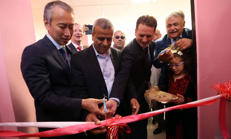From left: the Representative of Japan to the Palestinian Authority, Ambassador Takeshi Okubo; the Governor of Qalqilya, Rafa' Rawajbeh; UNRWA Commissioner-General, Pierre Krähenbühl; and the Mayor of Qalqilya, Othman Daoud, during the ribbon cutting ceremony. © 2016 UNRWA Photo by Alaa Ghosheh