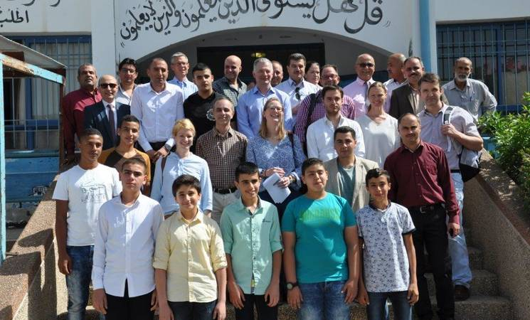AdCom and donor representatives pose with students who won the national robotics competition, Qalqilya Boys School. © 2016 UNRWA Photo by Kazem Abu Khalaf