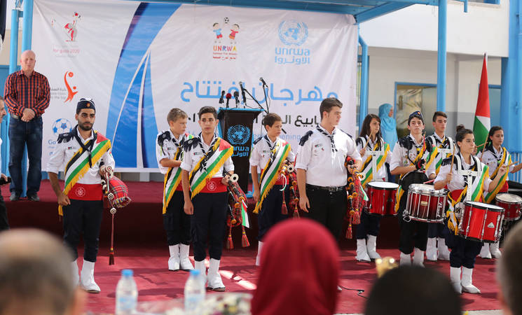 Orthodox scouting performing the Palestinian anthem during the opening ceremony of UNRWA 2016 Summer fun weeks at Al Zaitoun preparatory girls school (B) Photo credit: © UNRWA Gaza 2016. Photo by Tamer Hamam.