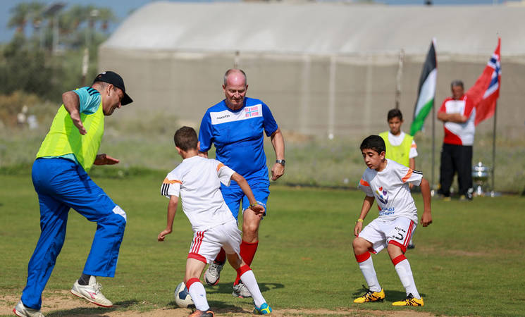 Head of the Representative Office of Norway to the Palestinian Authority, His Excellency, Hans Jacob Frydenlund, during a friendly game with the UNRWA youth football team at Al-Musader playground in Gaza. © 2016 UNRWA Photo by Rushdi Al Saraj