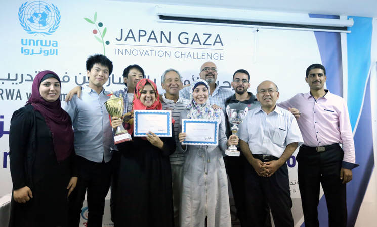 Gaza Entrepreneur Challenge judges and organizers accompanied by Dr. Akihiro Seita, Director of UNRWA Health Programme, with the two winning team-leaders in the Gaza Entrepreneur Challenge, at UNRWA Training Centre in Khan Younis, southern Gaza. © 2016 UNRWA Photo by Tamer Hamam