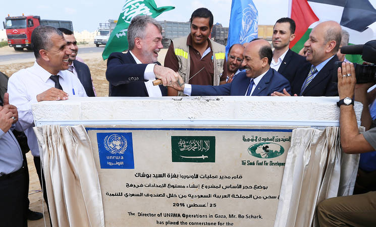 The Director of UNRWA Operations in Gaza, Bo Schack; the Palestinian Minister for Public Works and Housing, Mufeed al-Hasyna; and UNRWA Senior External Relations and Projects Officer, Munir Mannah, place the cornerstone for the construction of the Agency's largest logistics base in Gaza, located in Rafah, southern Gaza. © 2016 UNRWA Photo by Tamer Hamam