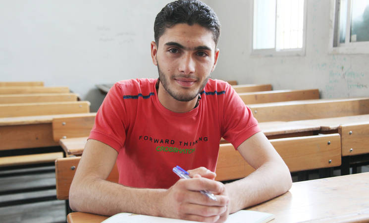 """I studied well for the exams despite the conflict. Education is my only hope to keep going forward and I will not give up on it,"" said Haytham Matar, a student from Darayya who recently completed his final exams in Damascus. © 2016 UNRWA Photo by Taghrid Mohammad"