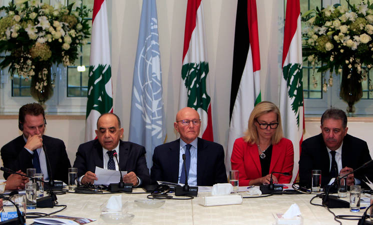(From left to right) UNRWA Commissioner-General Pierre Krähenbühl with the Chair of the Lebanon Palestinian Dialogue Committee, the Lebanese Prime Minister, the United Nations Special Coordinator for Lebanon and the Palestinian Ambassador to Lebanon calling for the completion of the reconstruction of Nahr el-Bared at the Nahr el-Bared Reconstruction Project Donors Meeting held in Beirut. © 2016 UNRWA Photo by Ali Hashisho