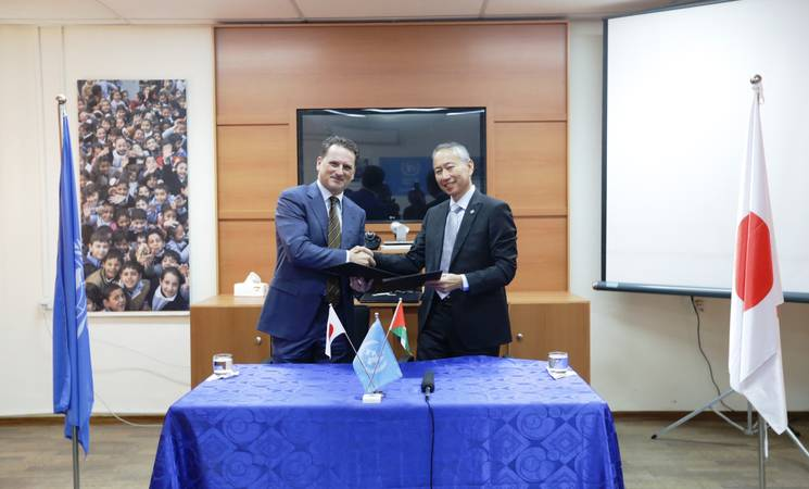 UNRWA Commissioner-General Pierre Krähenbühl (left) and Japanese Ambassador for Palestinian Affairs of Japan to the Palestinian Authority, Takeshi Okuba (right), shake hands. © 2016 UNRWA Photo by Isabel De La Cruz