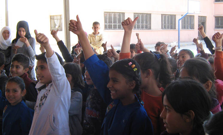 UNRWA Teachers 'Warm a Child'