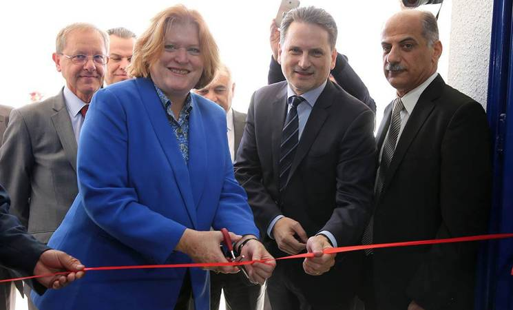 US State Department's Assistant Secretary of Population, Refugees, and Migration Anne C. Richard (left) and UNRWA Commissioner-General Pierre Krähenbühl (centre) cut the new school ribbon during the inauguration ceremony. © 2016 UNRWA Photo