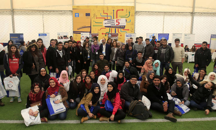Abel Piqueras Candela, Rrepresentative of the Delegation of the European Union to Lebanon, and the UNRWA team pose with a group of the Fair's participants. Hoops Club, Beirut. © 2016 UNRWA Photo by Ali Hashisho