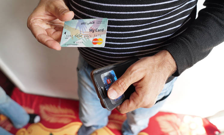 Mohammad accesses the cash assistance from UNRWA through the e-card programme, introduced in Jordan in April 2016. © 2016 UNRWA Photo by Christien van den Brink
