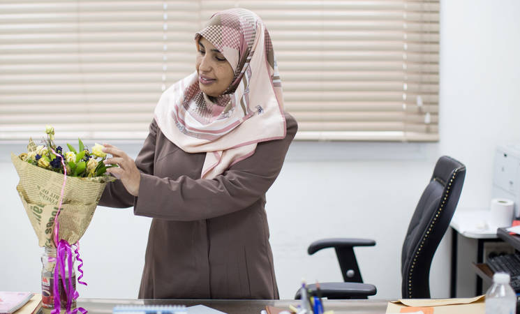 Wafa Diyab, UNRWA Recruitment Officer, received flowers from her colleagues in celebration of her UNRWA Gender Equality Champion Award. © 2017 UNRWA Photo by Tamer Hamam