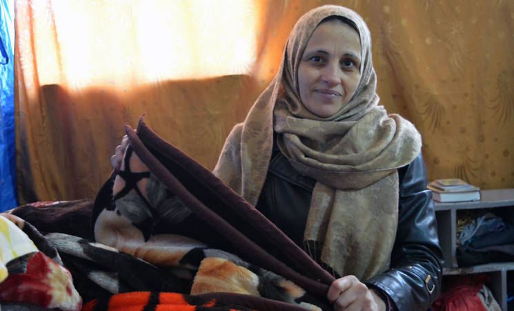 Myasar Othman lives with her children in the Damascus Training Centre, along with 180 other Palestine refugee families displaced by the war. © 2017 UNRWA Photo by Taghrid Mohammad